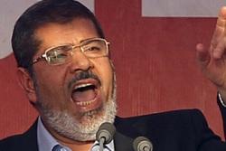 Egypt's Islamist President-elect Mohamed Mursi (R)